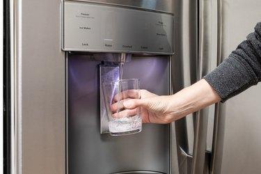 water dispenser in stainless steel refrigerator