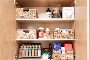 Pantry with spices and rattan boxes