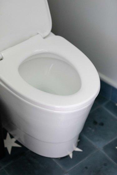 open toilet seat on modern toilet