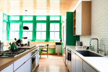 Kitchen with green paint and laminate counters