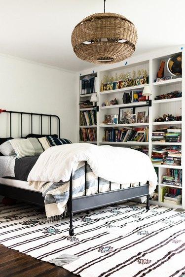 Bedroom with built in shelves