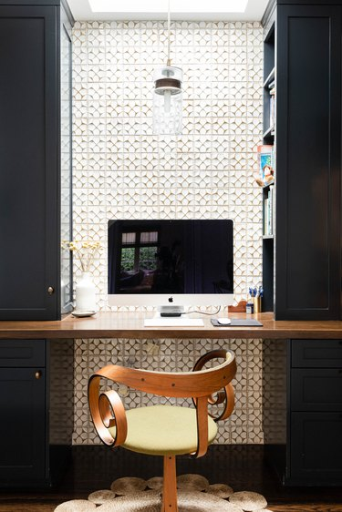 modern office nook with floating shelf desk and apple computer