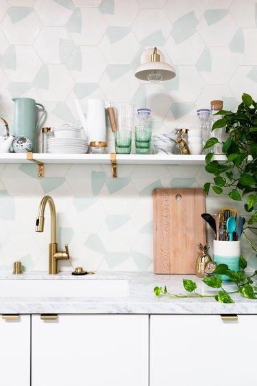 gooseneck kitchen faucet in brass finish