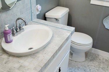 tile bathroom countertop in white and gray bathroom