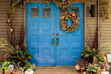 blue front door with fall wreath