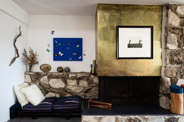 brass fireplace surround with stone mantel