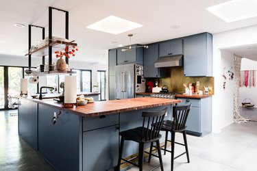 kitchen and dining area with blue cabinets