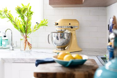 kitchen with yellow stand up mixer on countertop