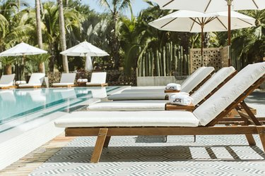 White lounge chairs and towels poolside