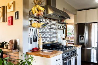 A kitchen with wood countertops and tile backsplash