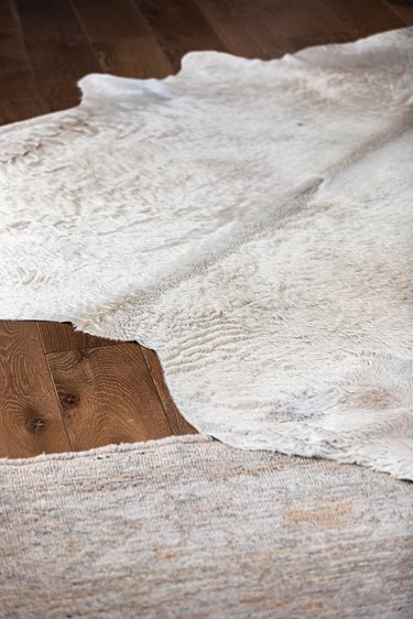 White rugs on a wood floor