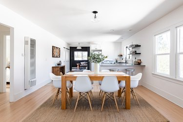 dining room with white eames-inspired chairs