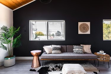 Black Room Ideas with Living room with black-white walls, wood ceiling, gray wood floors, gray-neutral furnishings