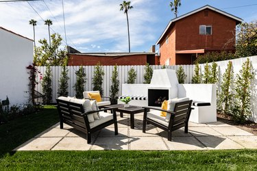 small patio on pavers with outdoor fireplace