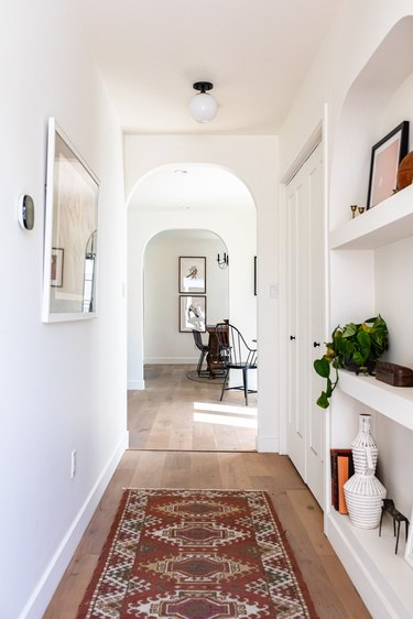 Hallway Furniture Ideas in white hall with rug