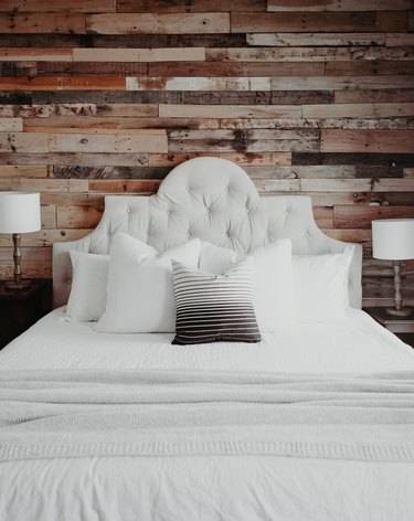 Farmhouse Chic Bedroom Ideas with Upholstered headboard with rustic wood paneling on wall