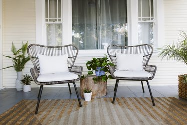 two chairs on porch with small side table