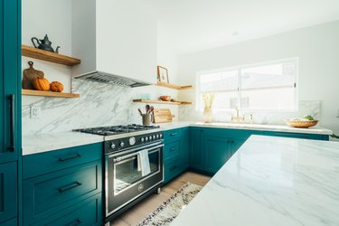 teal kitchen with marble countertop