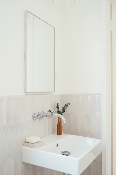 Small bathroom sink with ceramic tiles and mirror
