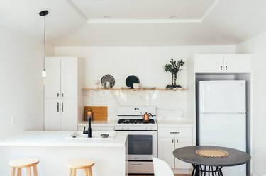 small kitchen design with hanging light