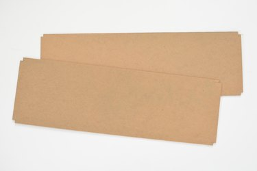 Two rectangular cardboard panels against a white background