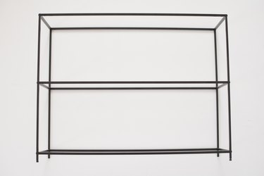 Black metal shelving frame against a white background