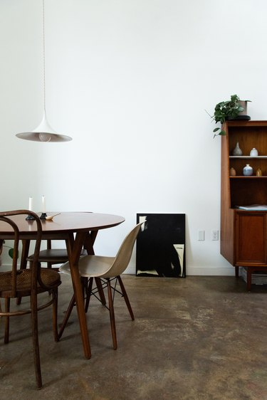 Mid-century modern dining room with round table and white hanging light