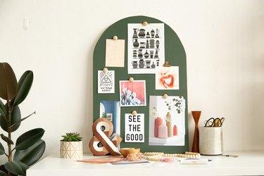 green moodboard near pencil cup