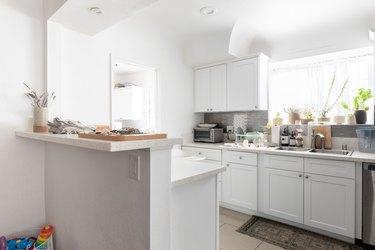 two-tier kitchen peninsula in white kitchen