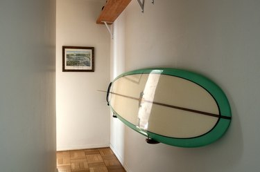 Surf board hung on a wall