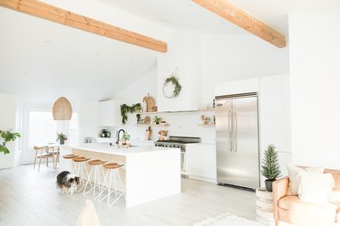 White boho kitchen with large white island and counter stools and contemporary Kitchen Island