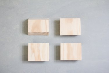 Four stacks of plywood sheets against grey background