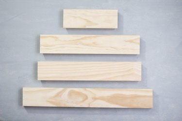 Four plywood panels against grey background