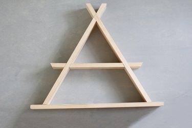 Wooden a-frame shelf against grey background