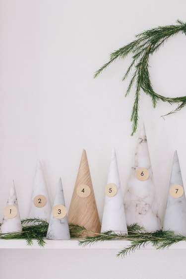 White, gray, beige paper cones with numbers for Christmas decorations list