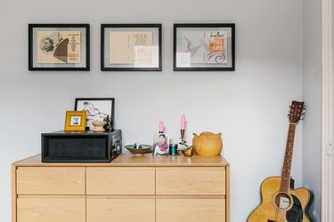 Gray color idea with wood cabinet and guitar