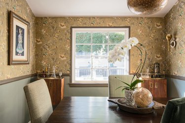 dining room wall decor idea for traditional dining room with floral wallpaper and white orchid plant