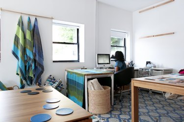 office with blue accents and wood furniture