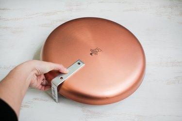 Round metal plat with flat brace