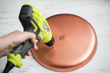 Round metal plate and drill
