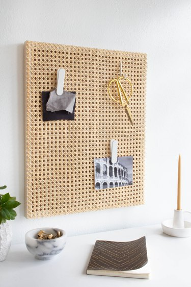 Homeschool Organization with Cane memo board over white desk with candle and notebook