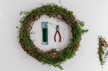 Faux Evergreen Christmas Wreath with wire cutters and green wire