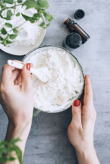 mixing essential oils into the baking soda and cornstarch mix