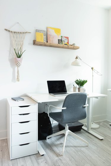 Office area with white desk and gray chair