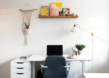 White office area with macrame plant holder and shelf