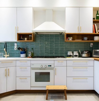 White kitchen with aqua glass subway tiles Ceramic Stovetop Cleaners