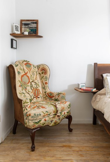 Farmhouse Chic Bedroom Ideas in Antique wingback chair in corner of bedroom