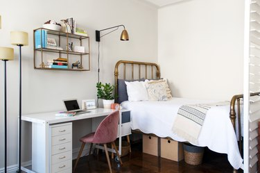 Bedroom with a shutter divider and an office desk