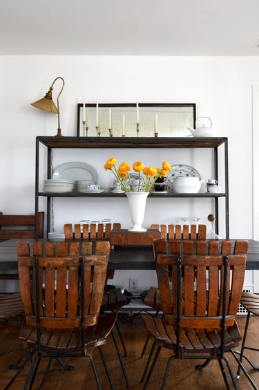 Dining room with dark farmhouse furniture and white walls