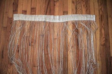 Neutral curtain fringe on wood floor